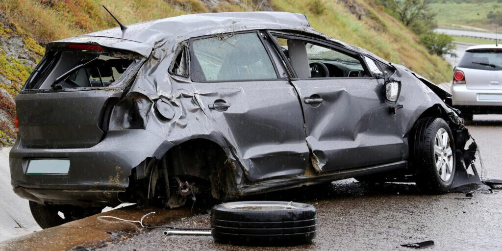 gray car accidents on the road